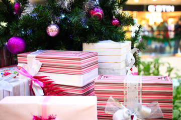 Close up of Decorated Christmas tree and boxes with bows