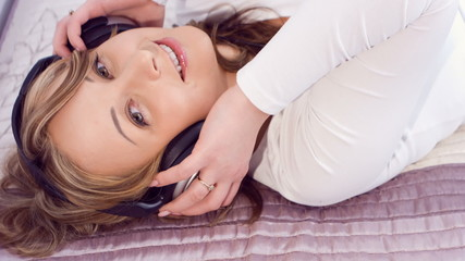 Pretty young woman love listening to music with headphones