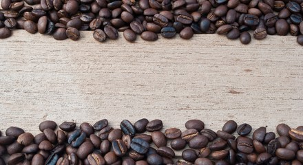coffee beans in rustic wood background - overhead view