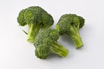 Tree fresh broccoli on white background