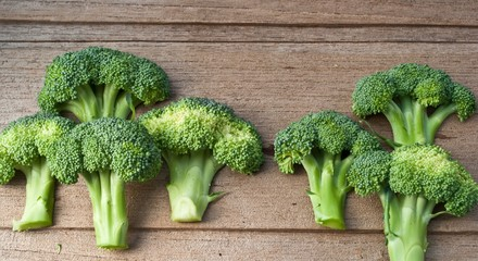 Fresh broccoli on the wooden table