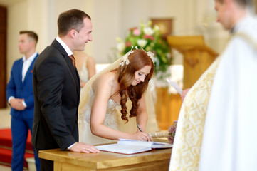 Bride and groom at the church during a wedding