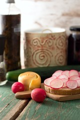Radishes, bread, smoked cheese and cucumber