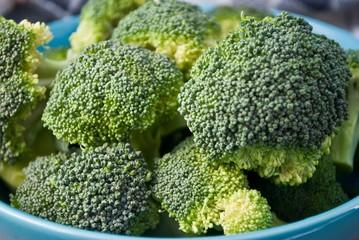 Fresh broccoli in blue bowl