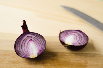 half a red onion on table