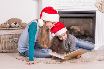 Sisters reading a Christmas story.