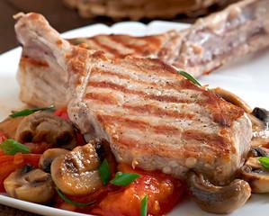 Juicy grilled pork steak on the bone