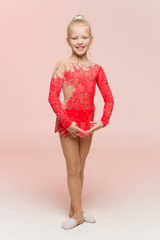 Beautiful girl gymnast in red leotard