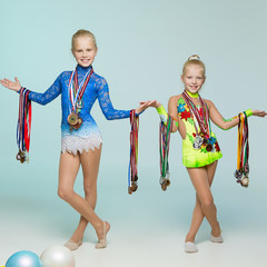 Young gymnasts with medals