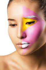 young attractive woman with bright colorful creative make up