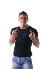 Handsome young man showing middle finger