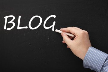Writing the word BLOG on a Blackboard