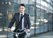 businessman riding a bicycle on the way to job