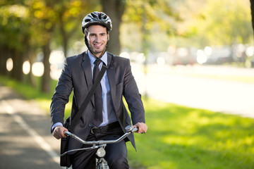 businessman riding a bicycle to work, concept  gas savings conce