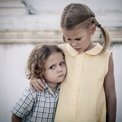 Portrait of sad little girl and boy