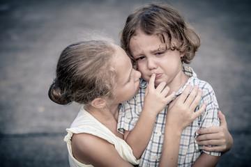 Portrait of sad teen girl and little boy