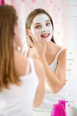 beauty girl getting facial mask