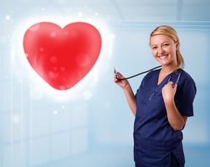 Young nurse healing a red heart