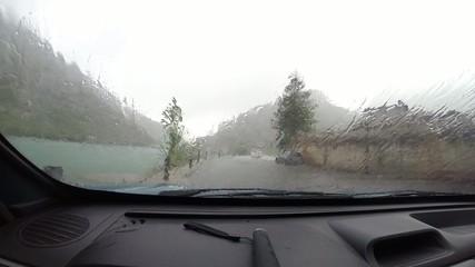 Car waiting at intense rain