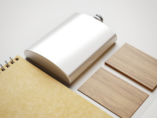 Flask, wood business cards and note on white paper background