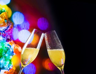 champagne flutes on christmas lights bokeh decoration background