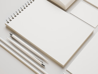 White note  and other branding elements on white paper backgroun