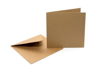 brown envelope with a blank card over white