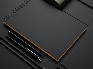 black branding elements on black paper