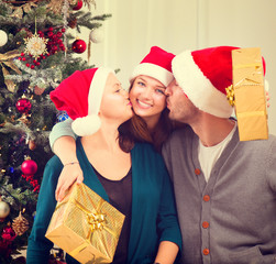 Christmas family portrait. Happy parents with teenage daughter