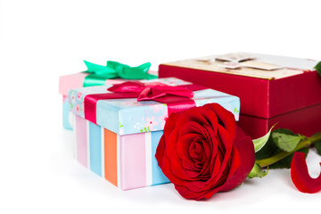 Colorful gift boxes and rose
