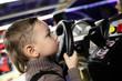 Boy playing with car simulator