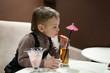 Child drinking apple juice