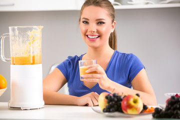 Smiling woman wit blender