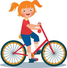 Child girl rides a bike