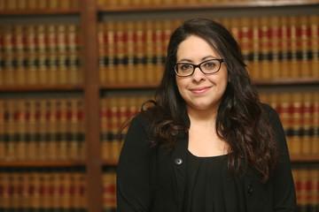 Young Female Hispanic Lawyer black dress
