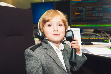 Toddler boy spend the day at his parent's work at the bank