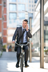 Full length of handsome men go to on work with bike