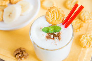 Milkshake (banana smoothie) with mint, nuts and cookies