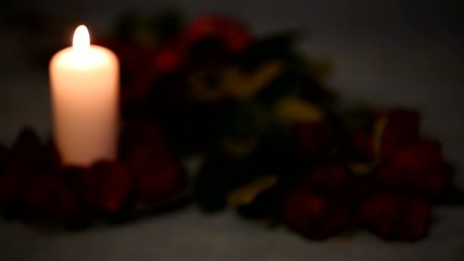 Valentine's Day red roses and candles.Variable focus