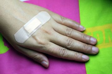Adhesive plaster on skin.