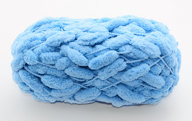 Blue yarn pompoms isolated on a white background