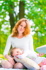 Vertical portrait of a mother and daughter in the park