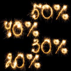 Sparkling inscription of 50%, 40%,30%, 20% on a black