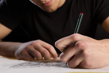 Artist drawing a tattoo
