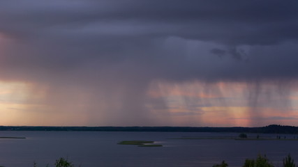 Thunderstorm with heavy rain over the lake