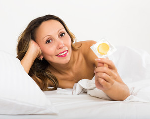 Beauty middle-aged woman with contraceptive