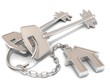 Two house door keys and house key-chain on white background - 74682861