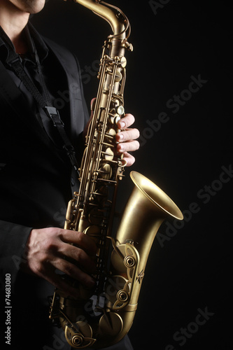 Saxophone player Saxophonist with sax alto - 74683080