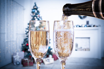 Two Champagne Glasses On Defocused Background Living Room