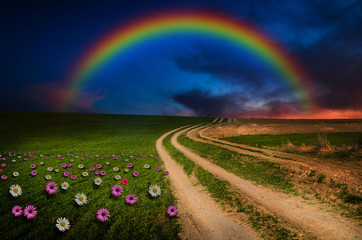 Rainbow in the night. Elements of this image furnished by NASA.